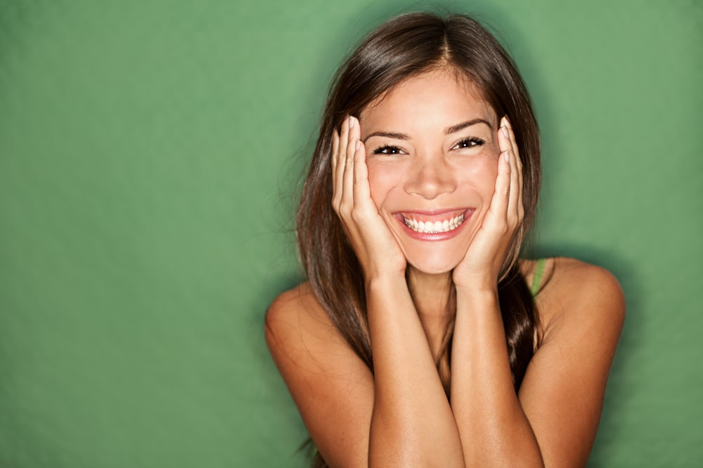 Smiling woman with green background