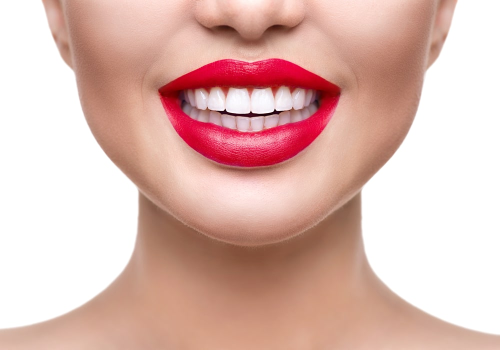 Teeth whitening. Healthy white smile closeup.